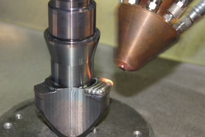 Laser beam cladding of a screw tip for an extrusion machine